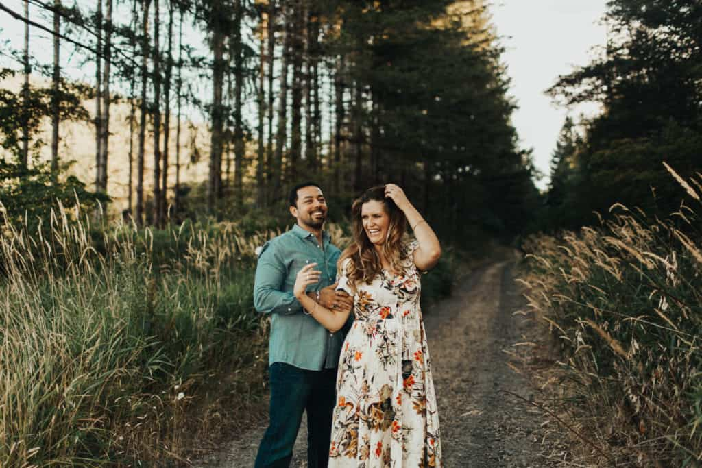 a newly engaged couple in oregon dance together