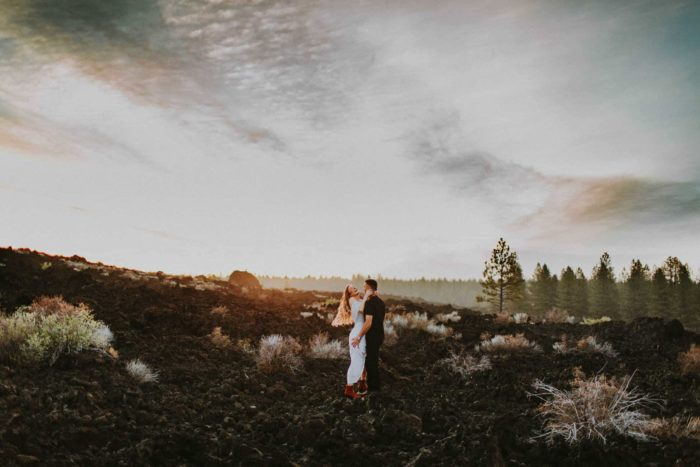 couple at their newberry volcanic monument engagement in bend oregon