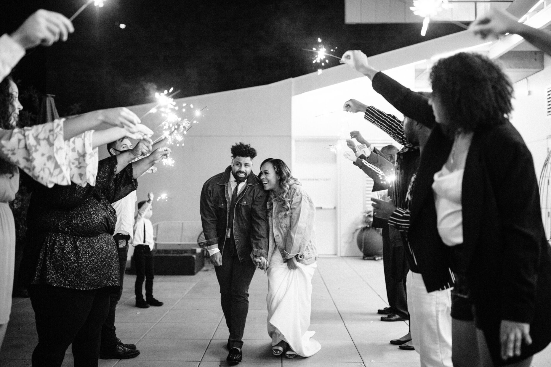 couple walking under sparklers at their Jupiter Next Wedding in Portland Oregon